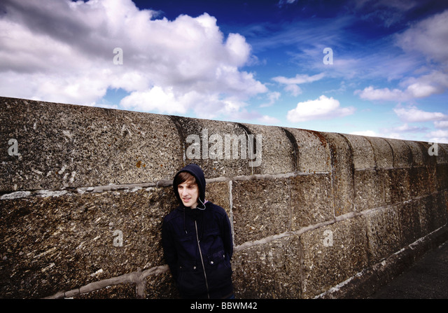 teenager-leaning-against-a-wall-bbwm42.j